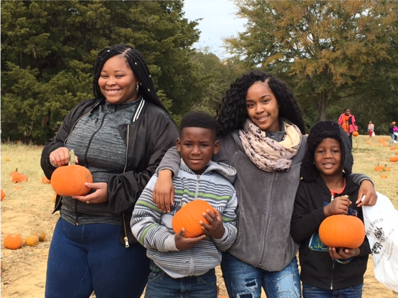 North Panola teacher academy student pick pumpkins with Como elementary